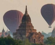 Photo of hot air balloons rising into the sky over Bagan, Burma.