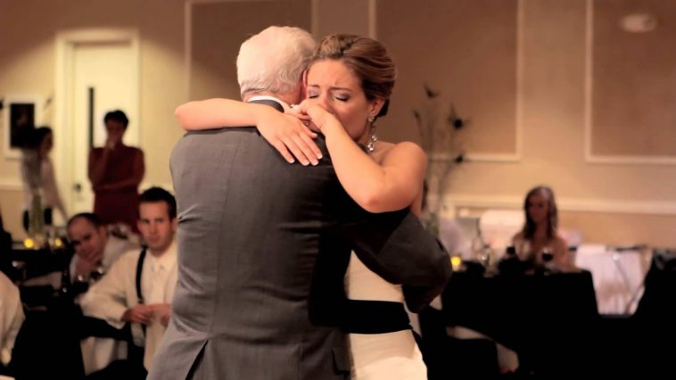 Photo of Andrea dancing with her grandfather.