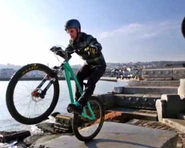 Photo of professional BMX cyclists riding through the streets of San Francisco.