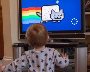 Photograph of a child watching the famous Nyan Cat video.