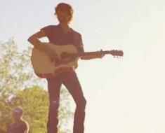 "Photo: Chris Janson sings in ""Buy Me a Boat"" music video."