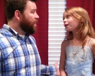 Photo of a father and daughter sing duet.
