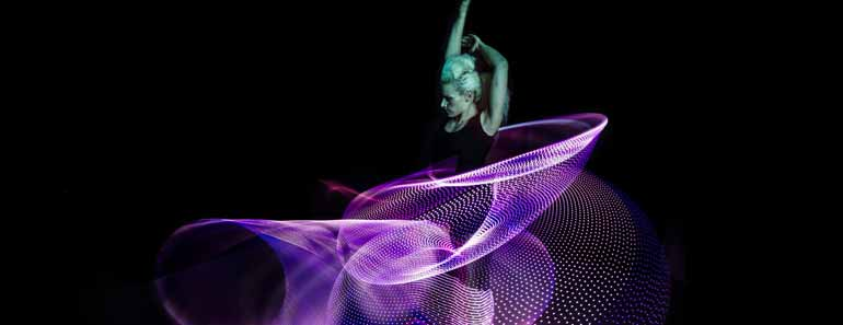 Photo of Lisa Lottie performing with an LED hula hoop.