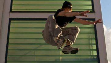 Male demonstrates parkour jump.