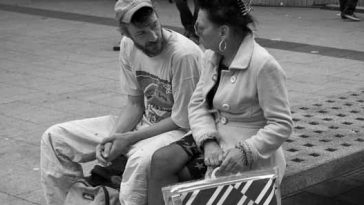 Photo of two people having a conversation. Two people in conversation. Image credit: Frank Lindecke / Flickr / CC.