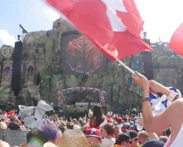 Photo of a crowd listening to music at the Tomorrowland EDM concert.