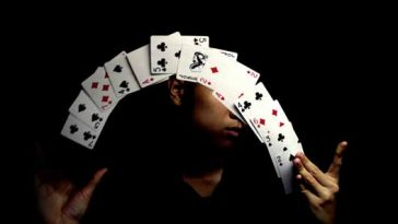 Photo of man shuffling a deck of cards in mid-air. Photo courtesy Jin Thai / Flickr.