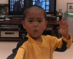 Photo of young boy performing as Bruce Lee.